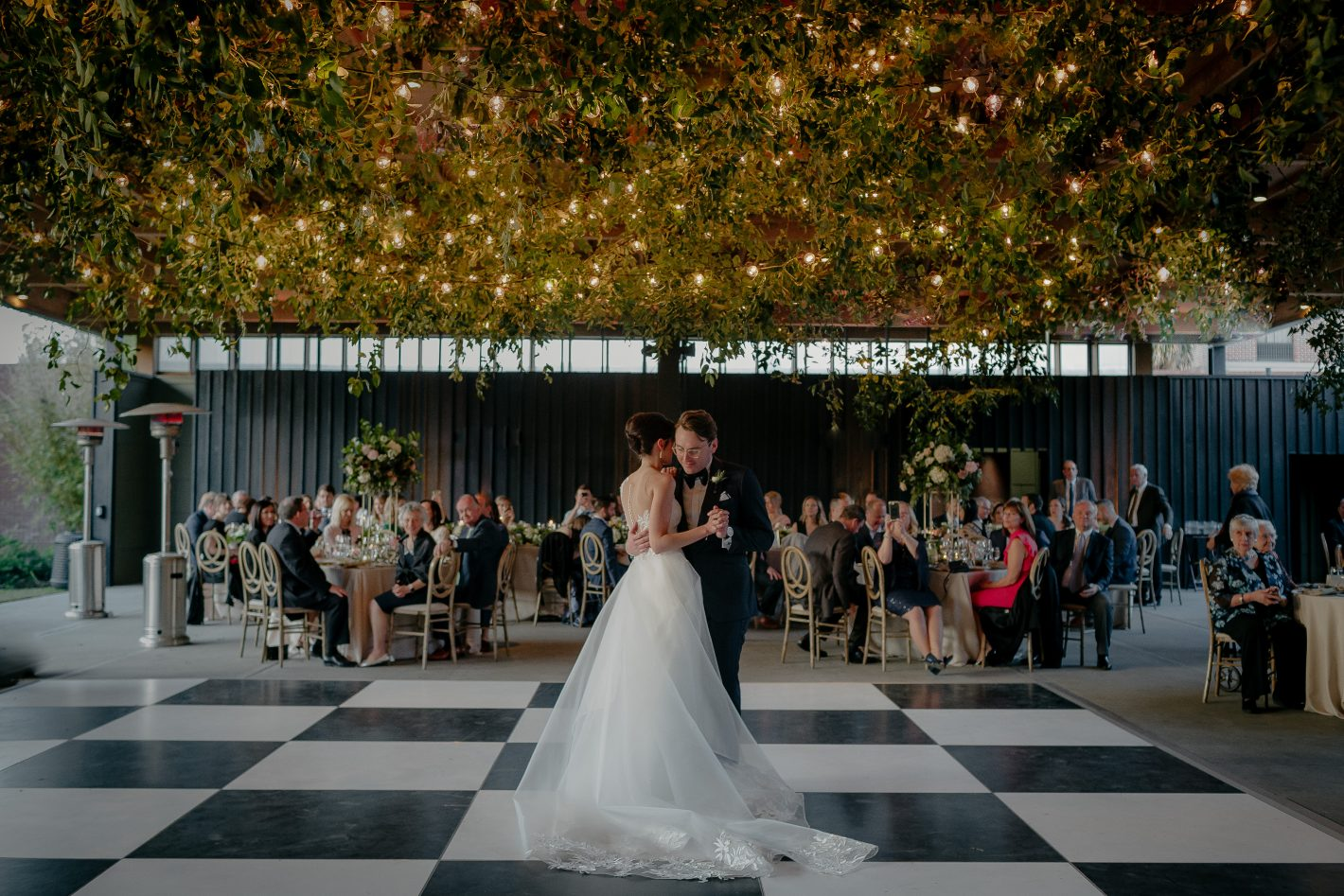 bride and groom first dance under twinkle lights at Ships of the Sea in Savannah